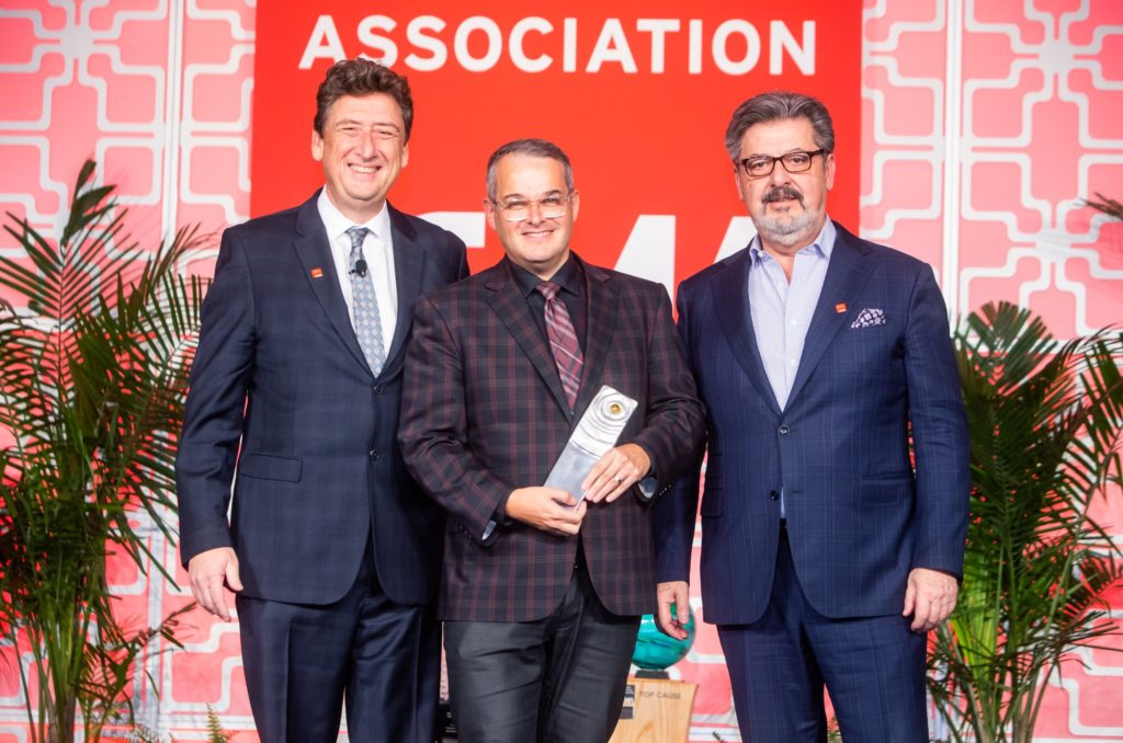 Stephen Brown (middle) accepts the Lifetime Achievement Award at last year's CMA Gala & Award Show.